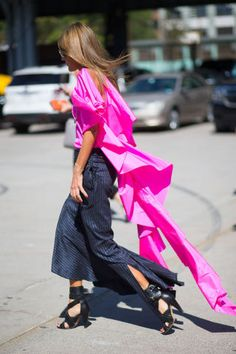 """Anna Dello Russo struts her stuff in this hot pink top on day 5 of NYFW. See all the """"off the runway"""" looks here."""