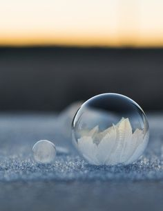 """Freezing temperatures can be miserable this time of year, but Angela Kellyhas used it to capture a spectacular phenomenonon film. The Washington-based photographer and her young son brave the cold with a bubble wand and a camera to take pictures of bubbles freezing in a matter of seconds. The images below show the final freeze, but a GIF near the bottom shows the entire process. Kelly explains the experience: """"We blew the bubbles across the top of our frozen patio table and also upon the…"""