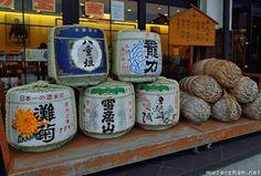 Defining images of Japan, traditional sake barrels and rice straw bales …