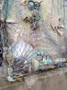 Close up of some amazing detail on this summer and beach inspired canvas by…karen for calico crafts by the sea graphic Hayselden - Chicken wire to hold in shells and act as a net. Mixed Media Collage, Mixed Media Canvas, Collage Art, Seashell Art, Seashell Crafts, Altered Canvas, Altered Art, Art Texture, Mixed Media Scrapbooking