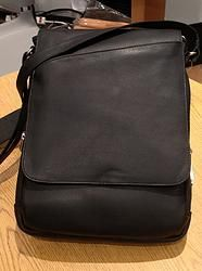 LWM-LYR16Take on the Estate in style with this casual-cool messenger bag. Made of smooth leather.Flap closure. Adjustable canvas crossbody strap. Lined interior with organizational zipper and slip pockets.Imported.
