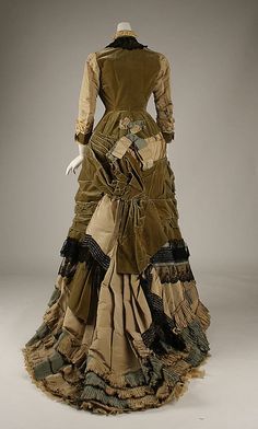 """Beige and green silk and olive green velvet dress, with beading and black lace trim (back), British, ca. 1878. Label: """"Elise, 170 Regent St., London"""""""