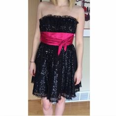 Betsey Johnson Dress Worn once Betsey Johnson Cocktail Dress.  Black sequins with a hot pink wrap around under the bust. Fun for an event or a school dance! Tag says Size 6 but I got tj altered to fit Size 0-2. Dress is in perfect condition. 🎀 Betsey Johnson Dresses Prom