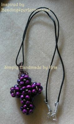 """2 3/4"""" Purple beaded double sided cross on a 20"""" black leather cord with handmade clasps  https://www.facebook.com/photo.php?fbid=453322971446062&set=a.417160598395633.1073741829.417149348396758&type=3&theater"""