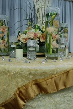 Soft vintage pallette....how romantic.  The ribbon table cloth is adorned with the embroidered satin band overlay.Design by Cloydon Dreamdecor  .