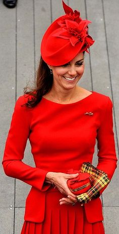 Striking ... The Duchess of Cambridge wore a bright red dress and clutched a small red bag and Strathearn tartan scarf, June 2012