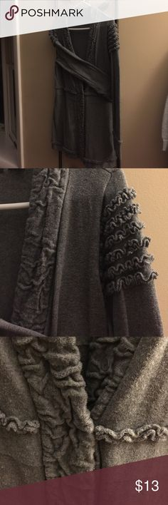 Lovely gray sweater Soft and comfy gray sweater with beautiful detailed ruffles on sleazed wrists and around the waist. Very slimming on Sweaters Cardigans