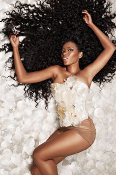 "Angela Simmons wearingJeantrix""seashell magic"" corset for her Indique hair ad"