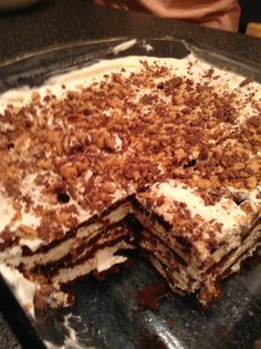 Heath Bar Crunch Ice Cream Cake -A layer of ice cream sandwiches  -A layer of whipped cream -A layer of Heath bar crunch -Repeat -Freeze overnight