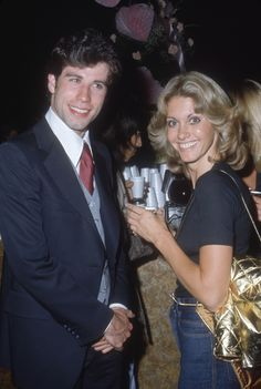 1977 - John Travolta and Olivia Newton John. Typical 70s hair