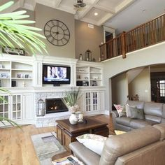 I need to somehow connect our fireplace w/ the built-ins and the high ceilings