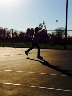 Tennis. Sometimes it's all about the lighting..or lack of it. Love this silhouetted picture of my daughter.