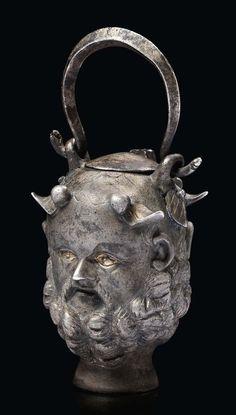 Balsamaire janiforme aux têtes de Silène, muni d'une anse de panier amovible - Argent partiellement doré - Art Romain, IIe-IIIe siècle