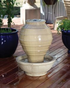 The Greek Jar Garden Water Fountain adds a touch of sophistication for your outdoor living space. It features a large Grecian jar standing boldly in the middle of a deep bowl base as the water streams
