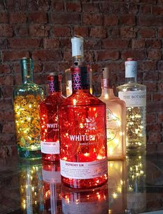bottle crafts Items similar to Upcycled, red Whitley Neill Raspberry Gin, led bottle lamp on Etsy Gin Bottles, Alcohol Bottles, Bottle Fairy Lights, Gifts For Gin Lovers, Bottle Centerpieces, Centrepieces, Centerpiece Ideas, Raspberry Gin, Gin Tasting