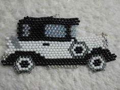 A model a car made out of seed beads pendent Carreau Seed Bead Art, Seed Bead Crafts, Seed Bead Projects, Seed Bead Jewelry, Beading Projects, Seed Bead Earrings, Seed Beads, Beaded Jewelry Patterns, Beading Patterns