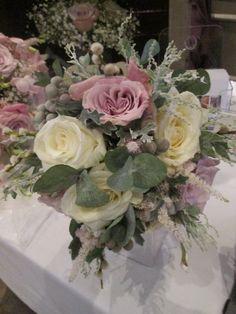 Mixed handtied bouquet of roses, brunia, mimosa, senecio and eucalyptus