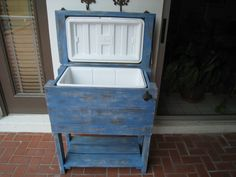 party patio cooler, hand made with old fence boards and pallets. distressed finish