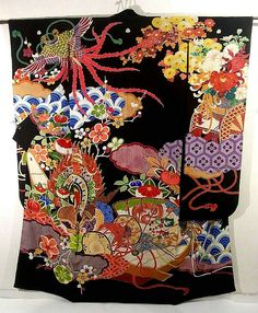Vintage Hon-Furisode with floating plumage, Sheng, Tsuzumi(Japanese hand drum), big drum, and Hana-ikada(flowers raft) pattern, which is gorgeously dyed. With its colorful motifs against the black background is very impressive!ICHIROYA