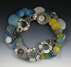 Polymer Necklace Belt II: Louise Fischer Cozzi: Polymer and sterling.  Etched, colored, and water transferred.  Each bead has been sanded, gilded, and varnished.