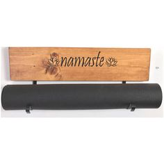 Yoga mat holder. These are wall mountable, handmade and functional pieces of art for your yoga space. It will hold your mat and keep it clean until your next session. You have found the Original designer and creator of these boards. Includes two black brackets, attached to the board. Pull