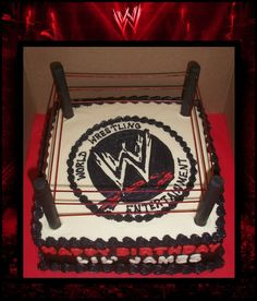 """WWE Wrestling Ring Cake : Double layered buttercream iced cake (sides are airbrushed black).  Pirouette cookies covered in fondant used for posts.  Dry spaghetti noodles """"painted"""" red with gel food coloring simply stuck in cookies.  Image drawn on top of ring and fondant letters on side."""