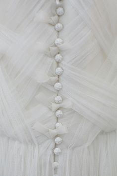 Tulle is on my dress! I like the buttons and how tulle makes everything so princessy.