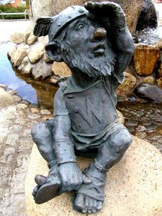 Wind dwarf Westri - statue by Jochen Muller;  four dwarves mark the four compass directions at the base of The Fountain of Wisdom;  at Mythenweg in Thale, Germany