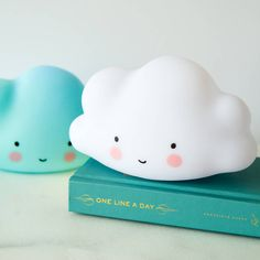 L.E.D. Cloud nightlight - complete with smiley face!This charming design is a perfect addition to any Children's room or nursery. The light emits a beautiful soft glow. Because there is an L.E.D. light in it, the material doesn't get hot and can it be safely used by children. Battery operated, so no unsightly cables to ruin your shelf display, but also great for taking to a strange house or camping, or by a bed where cables just can't reach! Why not add a 'Mini Me' pack to your order? Y...