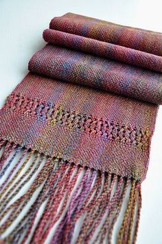 """Ravelry: thing4string's Fervent scarf. Plain woven scarf with leno ends and twisted fringe 12 dent heddle  95"""" warp  96 ends"""