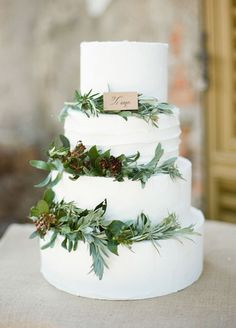 Wedding Cake : Olive leaves are a fresh and stylish addition to your classic white wedding cake.