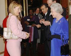 J.K. Rowling, the author of the Harry Potter Series of Books with The Queen of England dressed in Royal Blue of course circa 2004
