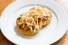 Salvadoran pupusas are a stellar corn flour pancake stuffed with fillings such as shredded cheese and braised meats, then griddled. Pupusas have the advantage of being stuffed before they're cooked, ensuring an irresistible gooey layer of cheese inside. Our recipe features a simple refried bean filling in addition to melted Oaxacan cheese, and gets topped with curtido, a simple cabbage, carrot and onion slaw.