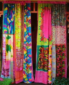 Patchwork curtains made with colorful scarves.