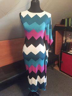 A personal favorite from my Etsy shop https://www.etsy.com/listing/225235287/chevron-batwing-dress