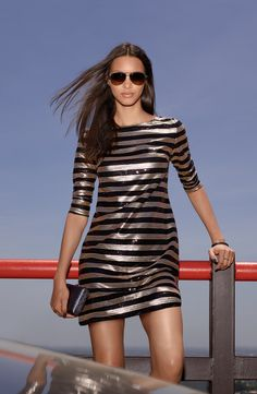 Obsessed with this gold and black stripe sequin shift dress!