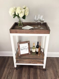 I'm super excited about today's post on how to build a bar cart! This  project has been in my head for months and the plans on how I was going to  actually build it changed forms many times. Basically, I wanted to make a  DIY bar cart that really looked like a custom, higher end bar cart and that  was also a bit rustic. I am thrilled at how it turned out after changing my  mind so many times about the design of it!       This DIY bar cart was a little more time consuming to build...