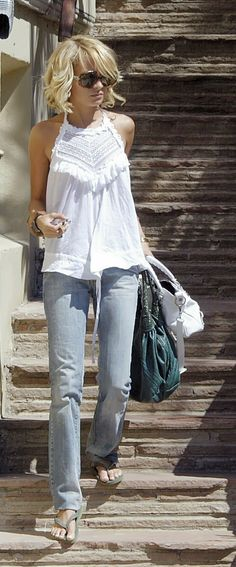 Lovely spring/summer fashion. White lace/crochet top plus vintage wash denim jeans. #style #fashion. women's fashion and street style. nicole richie.