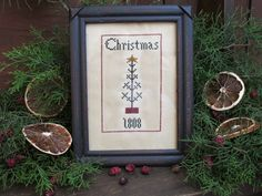 Christmas...designed & stitched by Yesterday Once More Primitives