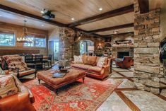 Rustic Basement with Hardwood floors, Bennett Square Leather Ottoman, stone fireplace, sandstone tile floors, Columns Basement Remodel Diy, Basement Renovations, Basement Ideas, Basement Makeover, Column Covers, Basement Pool, Rustic Basement, Lakefront Property, Column Design