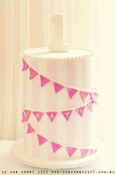 """Beading around the top of the cake with a """"1"""" candle."""