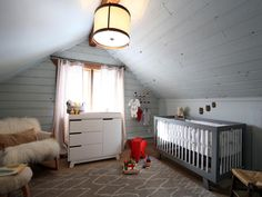 The couple turned a small upstairs bedroom into a nursery to accommodate their growing family. The neutral colors make it a sweet place for a baby, while the light pouring in from the window and the chandelier on the ceiling makes the space light.