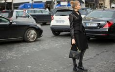 In Paris, model Elena Perminova waits for an Uber looking impossibly chic. How to achieve her look? Invest in a great pair of black combat boots, slide into your tightest skinnies, and layer with a long coat.