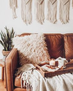 living room | sofa | couch | brown | leather | faux fur | cushion | neutral | plant | decor |