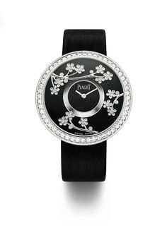 Piaget Altiplano watch set with 78 brilliant-cut diamonds. Manufacture Piaget 430P, ultra-thin hand-wound mechanical movement. Bracelet in black satin. #watch #piaget #amythicaljourney #flowers
