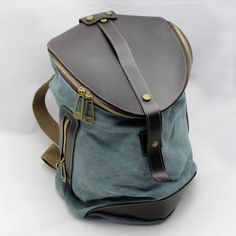 Using high quality canvas and crazy horse  leather production, with mobile phone bags,  computer sandwich, Shape is cylindrical. Material: excellent Canvas Antique cow  leather from Italy; durable cotton fabric  lining; bronze tone hardware Dimensions:  W: 11 (28 cm)  H: 15.35 (39 cm)  D: 7