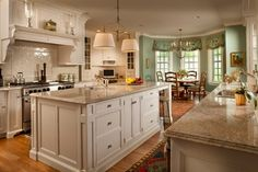 the light over island is pretty; like this granite combined with off white cabinets