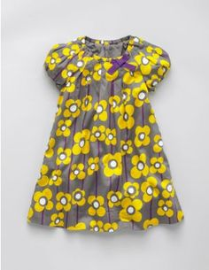 Dress. She's a summer colours girl. I love grey and yellow. Sun coming out from behind a cloud. That's my girl.