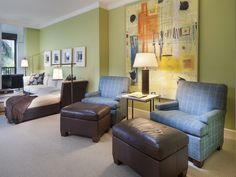 Blue chairs and brown leather ottomans - colorful contemporary artwork - green family room.  Toscana at Bay Colony | Naples, Florida