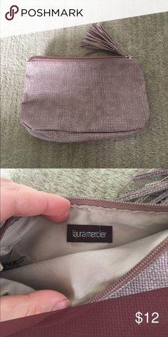Laura Mercier Makeup Case Brand new condition! Never used! Perfect for travel and easily fits inside a purse. Cute tassel zipper closure. Open to reasonable offers through feature! Laura Mercier  Bags Cosmetic Bags & Cases